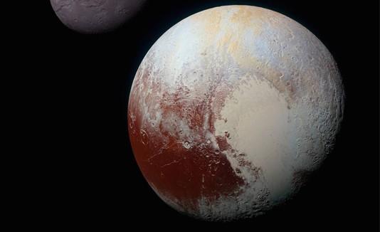 Plutón y su luna Caronte.