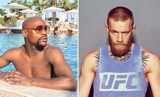 Conor McGregor y el retirado campeón de boxeo Floyd Mayweather Jr.