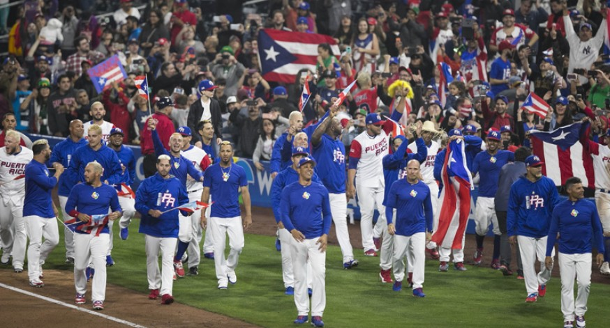 Los boricuas siguen triunfando en el Clásico Mundial de Béisbol. En esta imagen el equipo celebra su victoria sobre Estados Unidos, clasificando así a las semifinales.